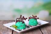 Ice cream with chocolate decorations — Stock Photo