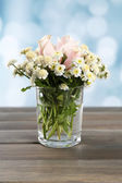 Beautiful flowers on table — Stock Photo