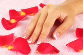 Woman's hand on pink terry towel, close-up — Stock Photo