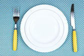 Knife, white plate and fork — Stock Photo