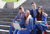 Students sitting on stairs — Stock Photo
