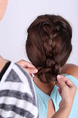 Creating hairstyles hairdresser — Stock Photo