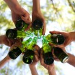 Hands holding beer bottles, close up — Stock Photo #49143603