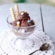 Chocolate ice cream with candies and wafer rolls — Stock Photo #49146691