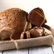 Fresh bread on wooden table — Stock Photo #49147895