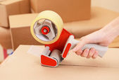 Packaging parcels with dispenser — Stock Photo