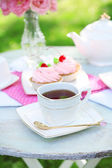 Teacups and cakes — Stock Photo