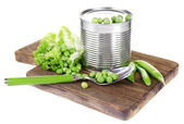 Fresh peas and tin — Stock Photo