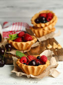 Tasty tartlets with berries — Stock Photo