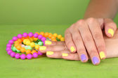Hand with stylish colorful nails — Stock Photo