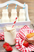 Milk in bottles — Stock Photo