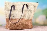 Summer wicker bag on sand — Stock Photo