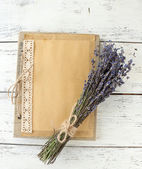 Lavender flowers and old photo album — Stock Photo