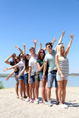 Group of friends at beach — Stock Photo