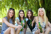 Group of friends having rest at park — Stock Photo