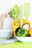 Plastic kitchen utensils in cup — Stock Photo