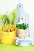 Plastic kitchen utensils in cup — Stock Photo