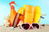 Bottles with suntan cream and sunglasses — Stock Photo
