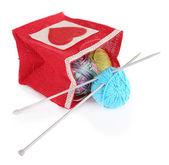 Woolen balls of yarn and knitting needles — Stock Photo
