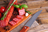 Tasty salami sausage and spices — Stock Photo