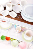 Different tableware on shelf — Stock Photo