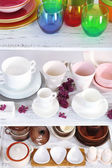 Different tableware on shelf — Stok fotoğraf
