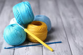 Colorful clews and crochet hook — Stock Photo