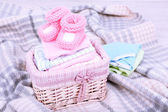 Baby clothes in basket — Stock Photo