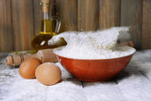 Flour in bowl on table — Stock Photo