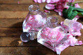Rose oil in bottles — Stock Photo
