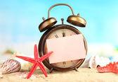 Old clock on sand — Stock Photo