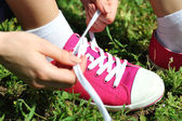 Woman tying shoelace — Stock Photo