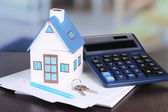 Toy house and calculator — Stock Photo