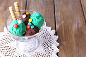 Chocolate ice cream with candies and wafer rolls — Stok fotoğraf