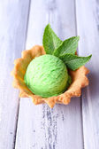 Green ice cream  ball in wafer bowl — Stok fotoğraf