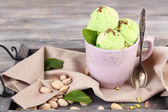 Pistachio ice cream in cup — Stock Photo
