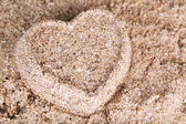 Heart-shaped wet sand — Stock Photo