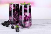 Blackberry lemonade with ice — Stock Photo