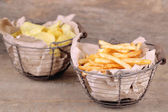 French fries in metal basket — Stock Photo