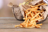French fries and potato chips in baskets — Stock Photo