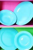 Bright shelves with tableware — Stock Photo