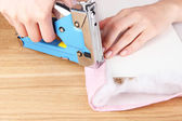 Fastening fabric and board using construction stapler — Foto de Stock