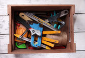 Wooden box with different tools — Fotografia Stock