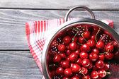 Sweet cherries in colander — Stock Photo