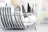 Clean dishes drying on metal dish rack — 图库照片