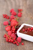 Ripe sweet berries and liquid chocolate — Stock Photo