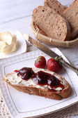 Toast with butter and strawberry jam — Stock Photo