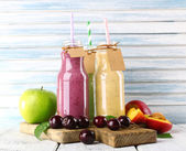 Bottles of delicious smoothie — Stock Photo