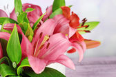 Lily flowers in crate — Stock Photo
