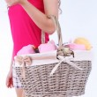 Woman holding laundry basket with clean clothes, towels and pins, isolated on white — Stock Photo #49204997